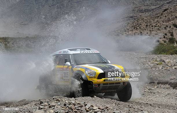 Spain's driver Nani Roma steers his Mini to win the Stage 3 of the 2012 Dakar between San Rafael Mendoza province and San Juan San Juan province...