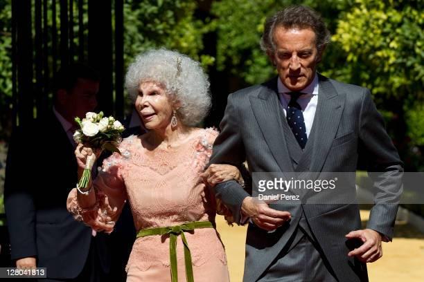 Spain's Duchess of Alba Maria del Rosario Cayetana FitzJamesStuart and her husband Alfonso Diez walk towards photographers after their wedding...