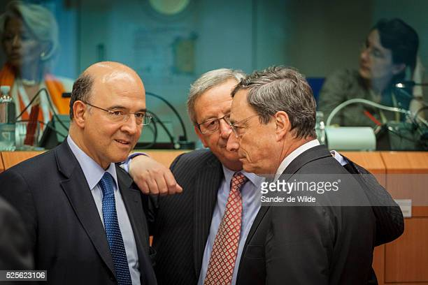 Spain's Economy Minister Luis de Guindos and President of the European Central Bank Mario Draghi with Luxembourg's Prime Minister and Eurogroup...