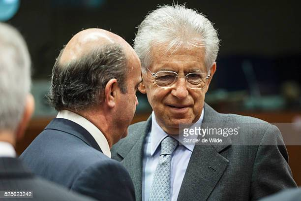 Spain's Economy Minister Luis de Guindos talks to Mario Monti prime minister and finance minster of Italy during an eurozone finance ministers...