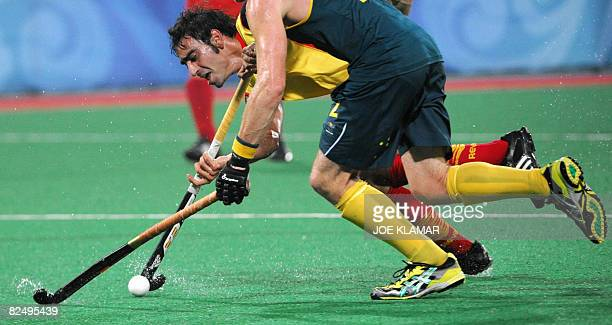 Spain's Eduard Arbos fights for the ball with Australia's David Guest during the semifinal match between Spain and Australia at the Olympic Green...