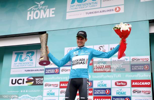 Spain's Eduard Prades Reverter who rides for the Euskadi Basque CountryMurias team poses for a photo with his trophy after winning the first place in...