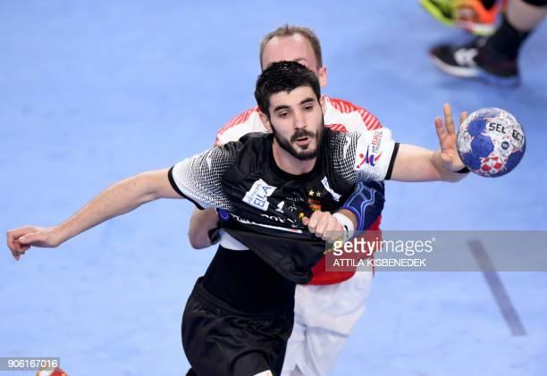Spain's Eduardo Gurbindo is pushed by Denmark's Rene Toft Hansen during their group 'D' match of the 13th Men's European Handball Championships...
