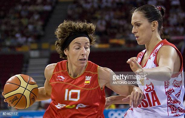 Spain's Elisa Aguilar figths for the ball with Russia's Ekaterina Lisina during the women's quarterfinal basketball match Russian Federation vs Spain...