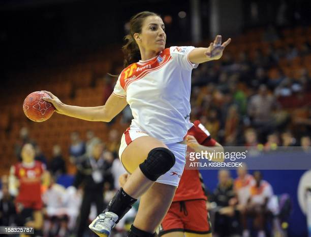 Spain's Elisabeth Pinedo jumps to score during the 2012 EHF European Women's Handball Championship Group II main round match against Montenegro on...