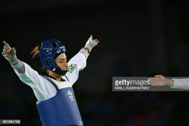 Spain's Eva Calvo Gomez celebrates after winning against Egypt's Hedaya Wahba in their womens taekwondo semi-final bout in the -57kg category as part...
