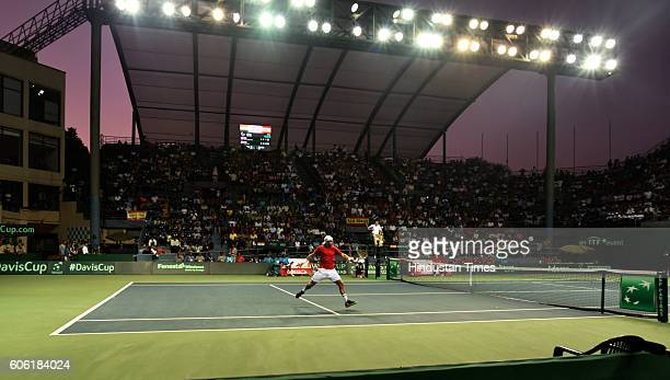 Spain's F Lopez in action against India's Ramkumar Ramanathan during Davis Cup World Group playoff Tie between India and Spain at DLTA on September...