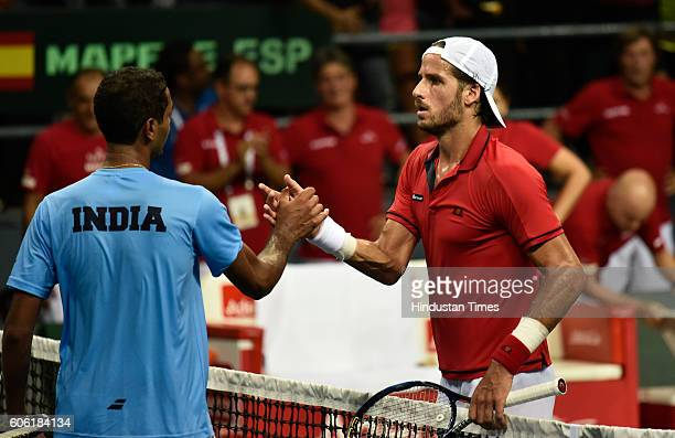 Spain's F Lopez shakes hand with India's Ramkumar Ramanathan after winning the match during Davis Cup World Group playoff Tie between India and Spain...