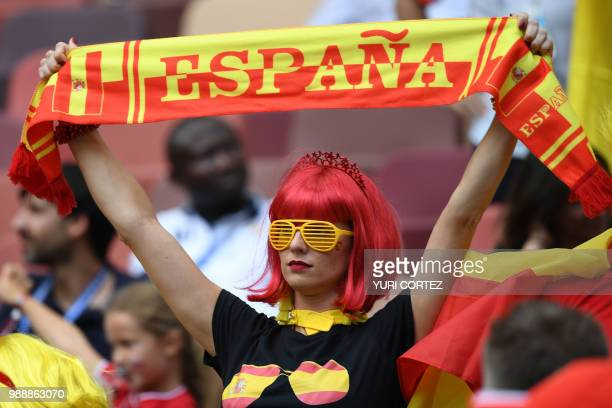 A Spain's fan brandishes a scarf before the Russia 2018 World Cup round of 16 football match between Spain and Russia at the Luzhniki Stadium in...