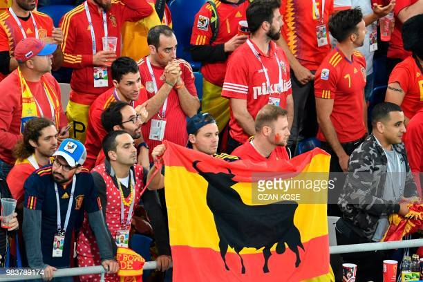 Spain's fans display a national flag with a bull during the Russia 2018 World Cup Group B football match between Spain and Morocco at the Kaliningrad...