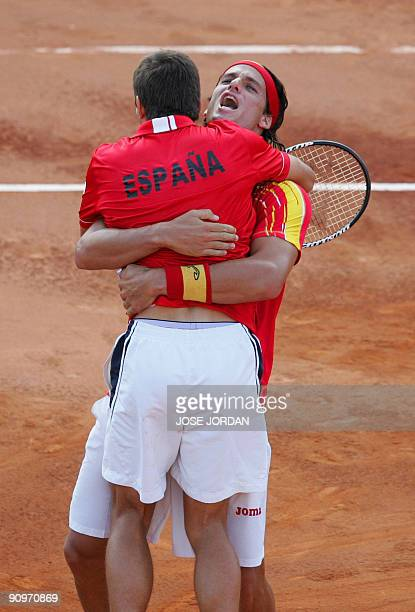 Spain's Feliciano Lopez and Tommy Robredo celebrate after winning the third match of the Davis cup semifinal between Spain and Israel against Andy...