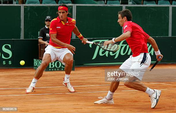 Spain's Feliciano Lopez and Tommy Robredo return the ball to Andy Ram and Jonathan Erlich from Israel during the semifinal Davis Cup match between...
