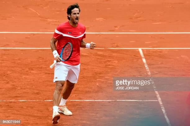 Spain's Feliciano Lopez celebrates after winning a set against Germany's Tim Puetz and Germany's JanLennard Struff during the Davis Cup quarterfinal...