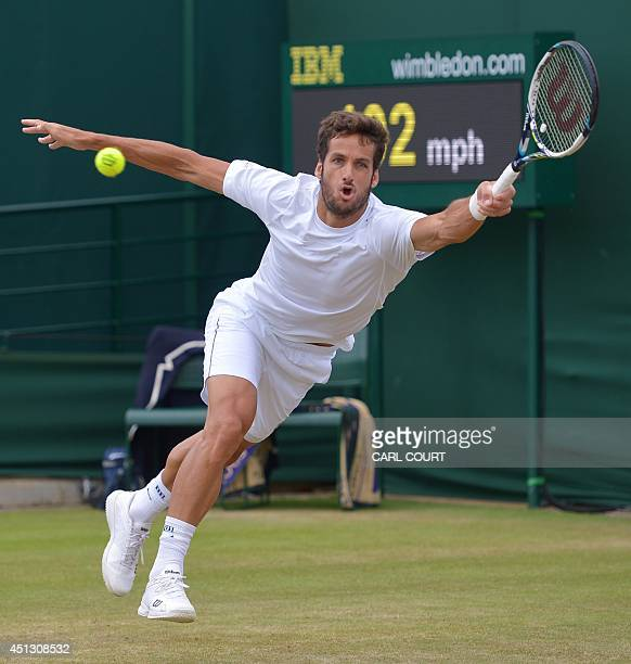 Spain's Feliciano Lopez returns against Croatia's Ante Pavic during their men's singles third round match on day five of the 2014 Wimbledon...