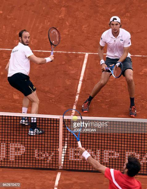 Spain's Feliciano Lopez returns the ball during the Davis Cup quarterfinal doubles tennis match against Germany's Tim Puetz and Germany's JanLennard...