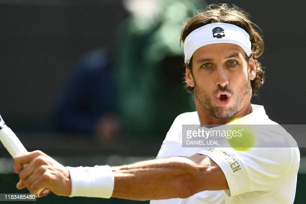Spain's Feliciano Lopez returns the ball to Russia's Karen Khachanov during his men's singles second round match on the third day of the 2019...