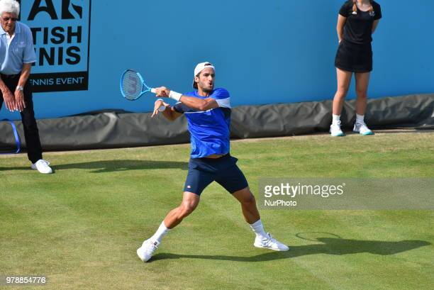 Spain's Feliciano Lopez returns to David Goffin of Belgium during their first round men's singles match at the ATP Queen's Club Championships tennis...