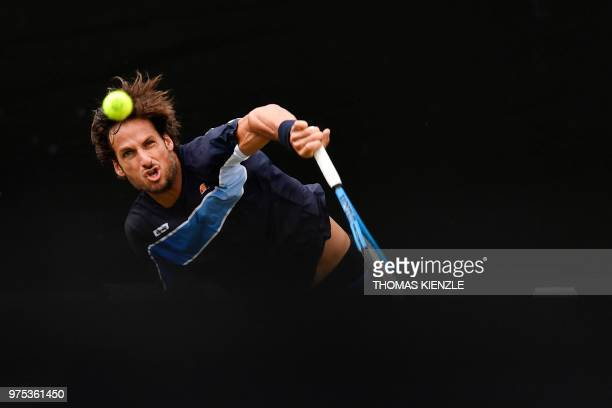 Spain's Feliciano Lopez serves to Australia's Nick Kyrgios during their quarterfinal match at the ATP Mercedes Cup tennis tournament in Stuttgart,...