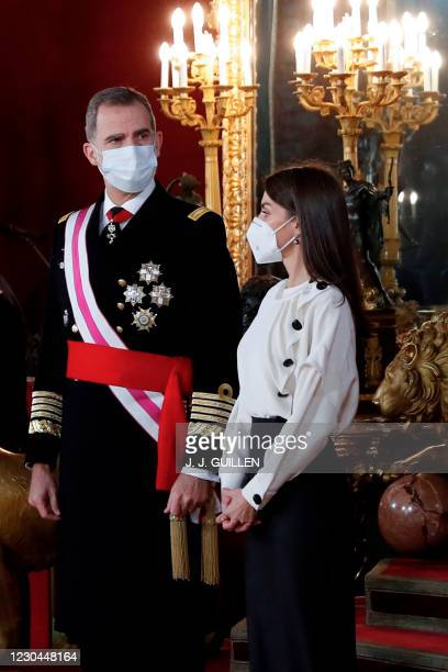 "Spain's Felipe VI and Queen Letizia attend the ""Pascua Militar"" traditional ceremony at the Royal Palace in Madrid on January 6, 2021."