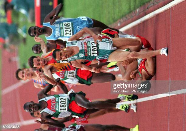 Spain's Fermin Cacho leaps in the air to avoid faller Hicham El Guerrouj during the final of the 1500m at the Olympic stadium Atlanta this evening...