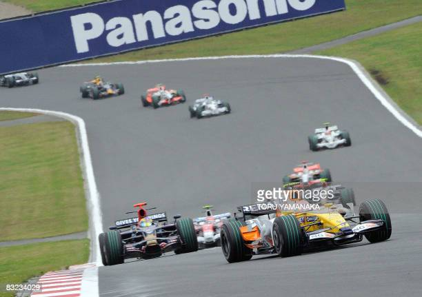 Spain's Fernando Alonso drives his Renault to lead other drivers in the Formula One Japanese Grand Prix at the Fuji Speedway some 100 kms west of...