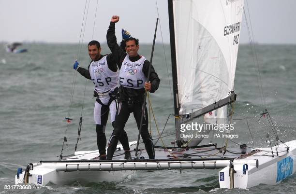 Spain's Fernando Echavarri and Anton paz celebrate winning Gold after the final race of the Men's Tornado class at the Qingdao Olympic Sailing Center...
