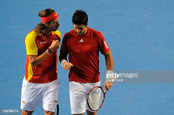 Spain's Fernando Verdasco and Spain's Feliciano Lopez reacts during their Davis Cup first round match against Belgian's Olivier Rochus and Belgian's...