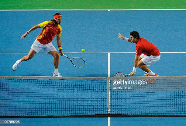 Spain's Fernando Verdasco and Spain's Feliciano Lopez returns the ball against Belgians Olivier Rochus and Steve Darcis during the Davis Cup first...
