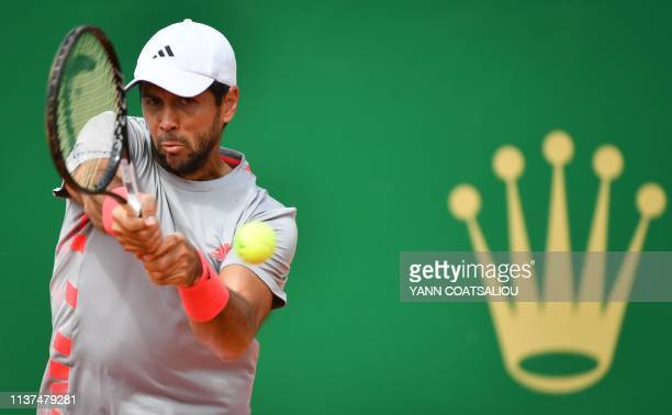 Spain's Fernando Verdasco plays a backhand return to France's PierreHugues Herbert during their tennis match on the day 4 of the MonteCarlo ATP...