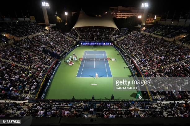 Spain's Fernando Verdasco plays against world number one Andy Murray of Great Britain during their ATP final tennis match as part of the Dubai Duty...
