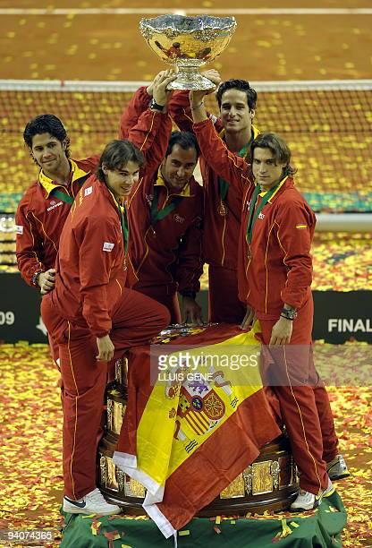 Spain's Fernando Verdasco, Rafael Nadal, team captain Albert Costa, Feliciano Lopez and David Ferrer celebrate after winning the Davis cup final...