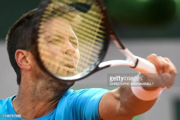 Spain's Fernando Verdasco returns the ball to Britain's Daniel Evans during their men's singles first round match on day three of The Roland Garros...
