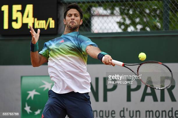 Spain's Fernando Verdasco returns the ball to US player Steve Johnson during his men's first round match at the Roland Garros 2016 French Tennis Open...