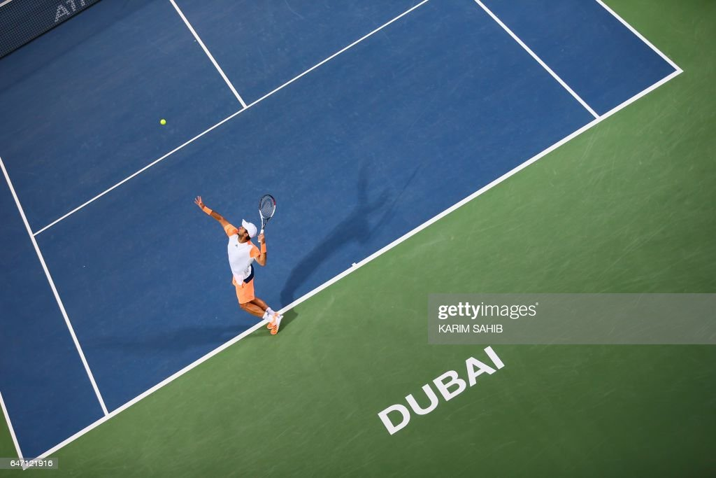 Spain's Fernando Verdasco serves the ball to Gael Monfils of France during their ATP quarter-final tennis match as part of the Dubai Duty Free Championships on March 2, 2017, in Dubai. /