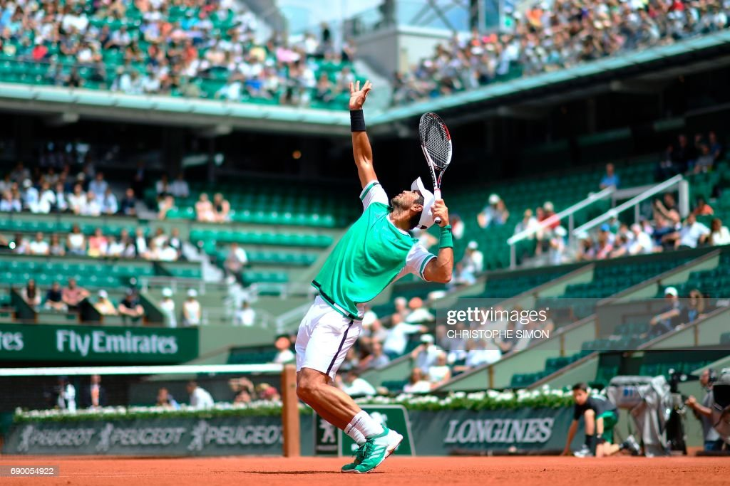 Spain's Fernando Verdasco serves the ball to Germany's Alexander Zverev during their tennis match at the Roland Garros 2017 French Open on May 30, 2017 in Paris. /