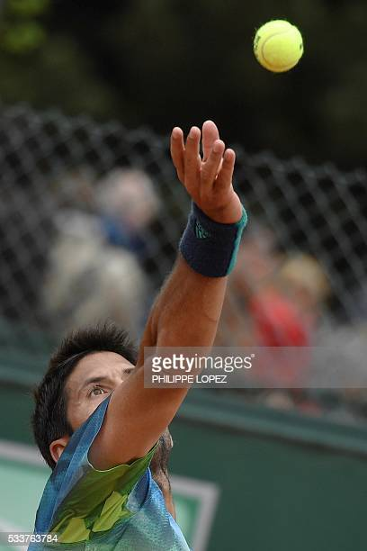 Spain's Fernando Verdasco serves the ball to US player Steve Johnson during his men's first round match at the Roland Garros 2016 French Tennis Open...