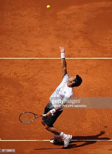 Spain's Fernando Verdasco serves to his fellow countryman Juan Carlos Ferrero during their match of the ATP Madrid Masters claycourt tournament on...
