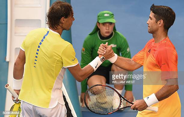 Spain's Fernando Verdasco shakes hands as he celebrates after victory in his men's singles match against compatriot Rafael Nadal on day two of the...