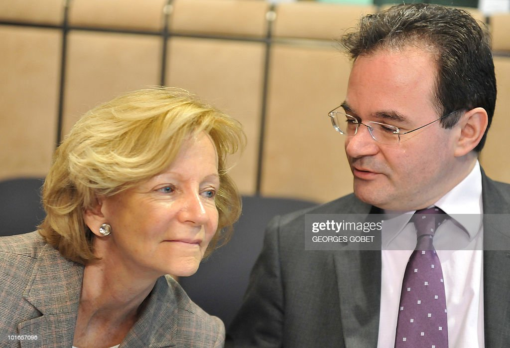 Spain's Finance Minister Elena Salgado and Greece's Finance Minister George Papaconstantinou talk on May 17, 2010 prior to an Eurogroup meeting at the EU headquarters in Brussels. Jean-Claude Juncker said on May 17 he was concerned at the speed of the euro's fall on foreign exchange markets though not about its current levels. 'I am not worried as far as the current exchange rate is concerned, I'm worried as far as the rapidity of the fall is concerned,' Luxembourg Prime Minister Juncker said as he arrived for a meeting of the 16 eurozone finance ministers in Brussels.