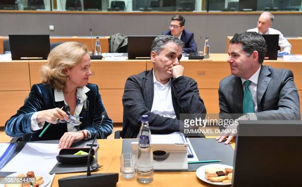 Spain's Finance Minister Nadia Calvino Greece's Finance Minister Euclid Tsakalotos and Ireland's Finance Minister Paschal Donohoe look on prior to...