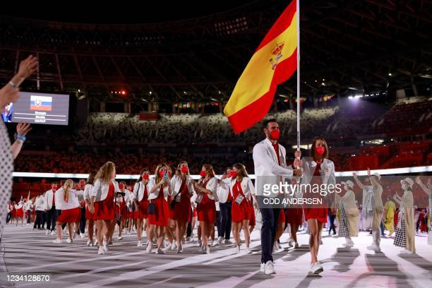 Spain's flag bearers Mireia Belmonte and Saul Craviotto lead their delegation as they parade during the opening ceremony of the Tokyo 2020 Olympic...