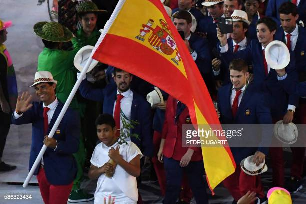 Spain's flagbearer Rafael Nadal leads his delegation during the opening ceremony of the Rio 2016 Olympic Games at the Maracana stadium in Rio de...