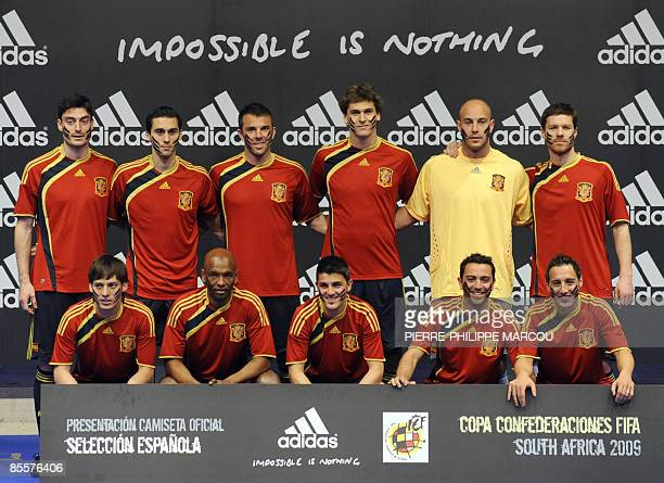 Spain's football national squad display the new jersey they will use for the FIFA Confederations Cup 2009 in South Africa in Las Rozas on March 24...