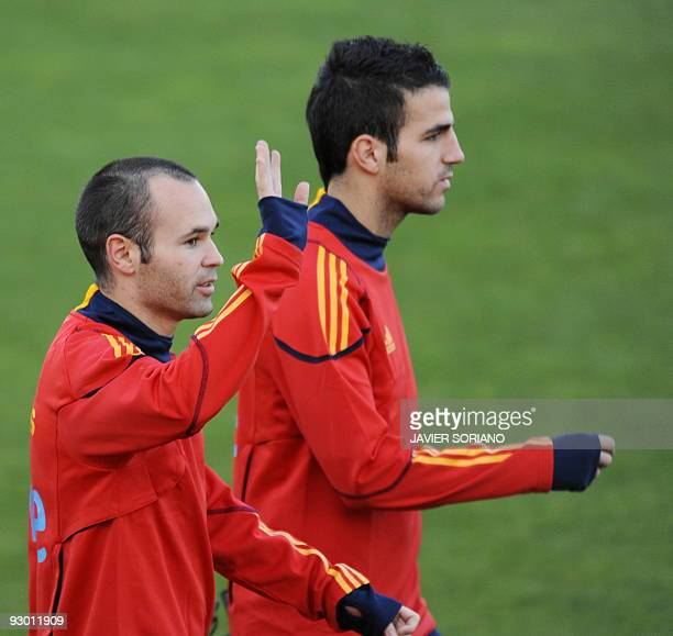 Spain's football players Cesc Fabregas and Andres Iniesta arrive for a training session at Las Rozas Sport City near Madrid on November 12 2009 Spain...