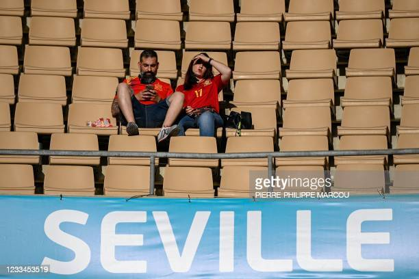 Spain's football supporters wait for the UEFA EURO 2020 Group E football match between Spain and Sweden at La Cartuja Stadium in Sevilla on June 14,...