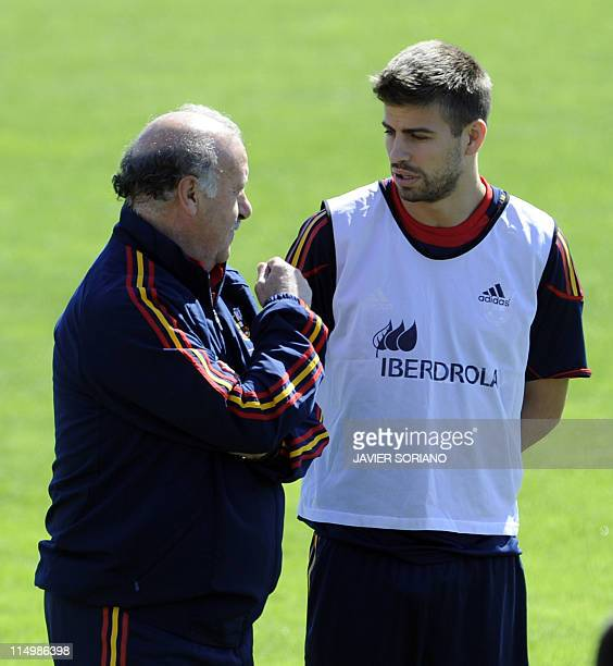 Spain's football team coach Vicente del Bosque chats with Gerar Pique during a training session at Football City in Las Rozas near Madrid on June 1...