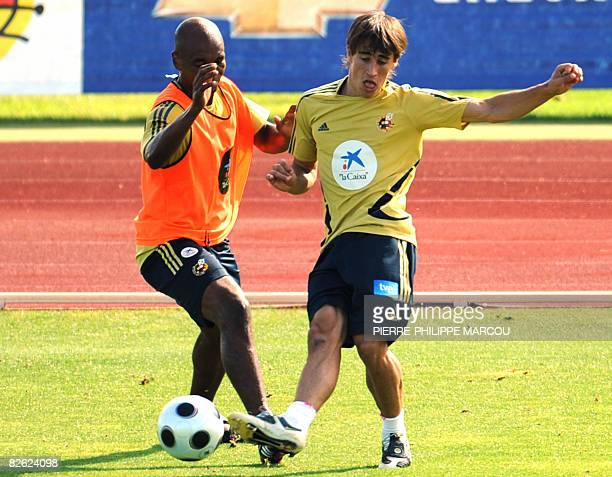 Spain's football team player Bojan Krkic fights for the ball with Marcos Senna during a training session in Las Rozas near Madrid on September 2 2008...