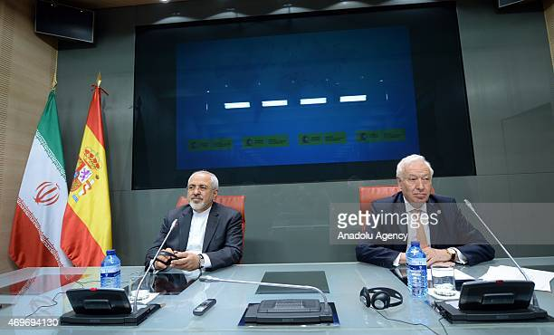 Spain's Foreign Minister Jose Manuel Garcia Margallo and Iranian Foreign Minister Mohammad Javad Zarif hold a joint press conference after their...