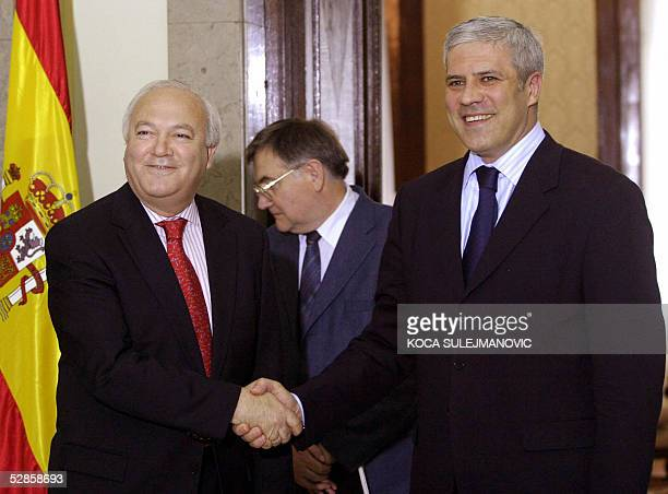 Spain's Foreign Minister Miguel Angel Moratinos shakes hands with Serbia President Boris Tadic 17 May 2005 in Belgrade Moratinos backed Serbia and...