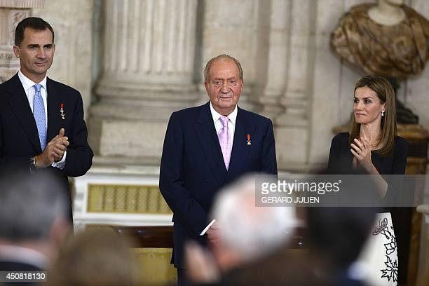 Spain's former King Juan Carlos is congratuled by Spain's Prince Felipe VI and Spanish Princess Letizia during a ceremony of approval and enactment...